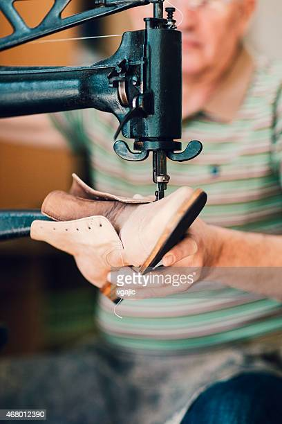 unrecognizable shoemaker at work. - shoemaker stock photos and pictures