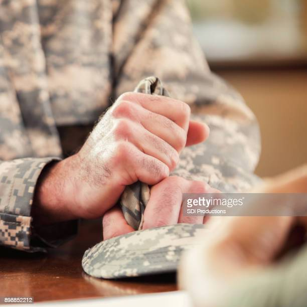 unrecognizable soldier talks with mental health professional - military doctor stock photos and pictures