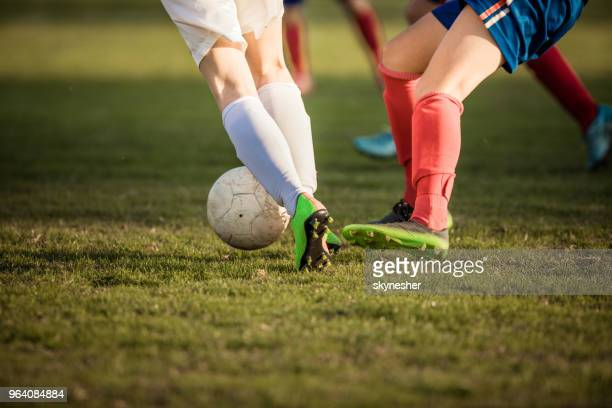 unrecognizable sportswoman passing her rival on a soccer match. - women's football stock pictures, royalty-free photos & images