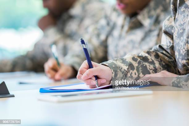 unrecognizable veterans take a college course - armed forces stock pictures, royalty-free photos & images