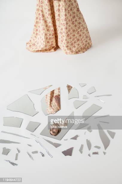 unrecognizable woman reflecting in splintered mirror - vogue stock pictures, royalty-free photos & images