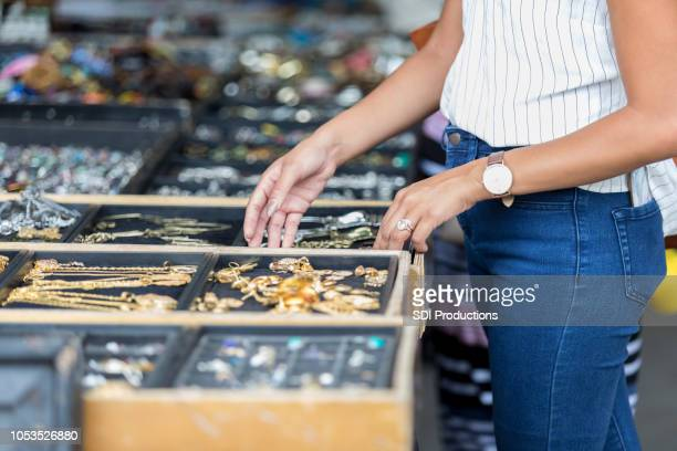 unrecognizable woman shops in bazaar market for jewelry - pocket stock photos and pictures