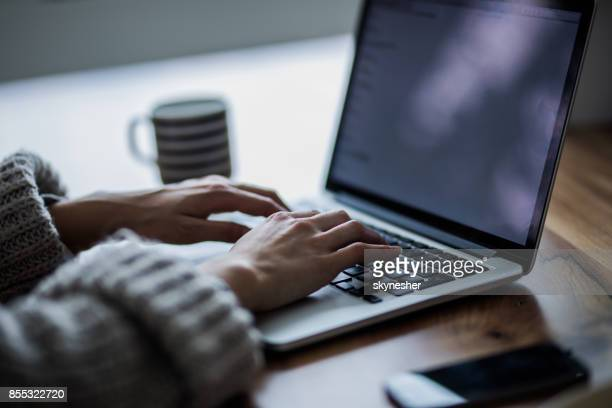 unrecognizable woman typing an e-mail on laptop. - unrecognizable person stock pictures, royalty-free photos & images