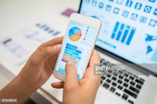 unrecognizable woman using an app looking at statistics - pie chart stock pictures, royalty-free photos & images