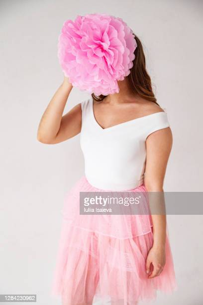 unrecognizable woman with pink flower in studio - tulle netting stock pictures, royalty-free photos & images