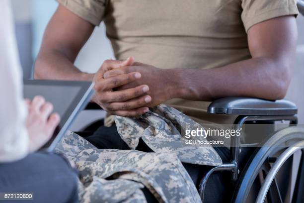 unrecognizable wounded military officer talks to therapist - injured soldier stock photos and pictures