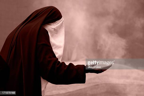 Unrecognized muslim woman praying
