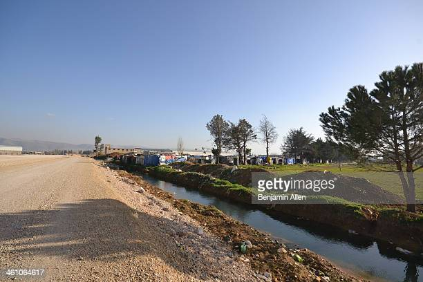 Unregistered refugee camp on the side of the Damascus-Beirut highway in the Bekaa Valley, Lebanon, March 2013