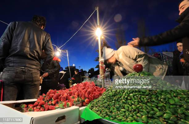 Unripe almonds and Strawberry await purchase as Iranians shopin in Tajrish Square to celebrate Nowruz, the Persian New Year, on March 20, 2019 in...