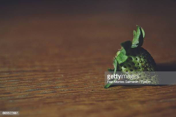 Unripe Strawberry On Table