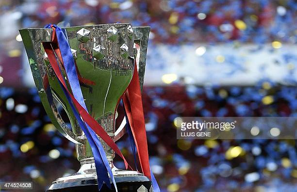 Unseen Barcelona's midfielder Xavi Hernandez holds up the trophy for the Spanish league title of 2014/15 after the Spanish league football match FC...