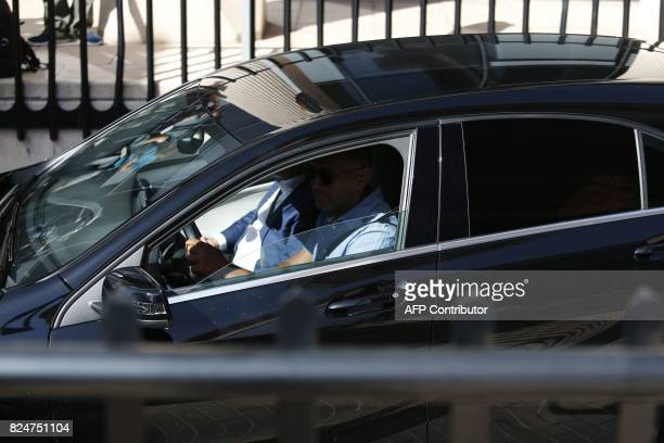 Unseen Real Madrid's Portuguese forward Cristiano Ronaldo arrives in a vehicle with tinted windows to appear at a court in Pozuelo de Alarcon a...