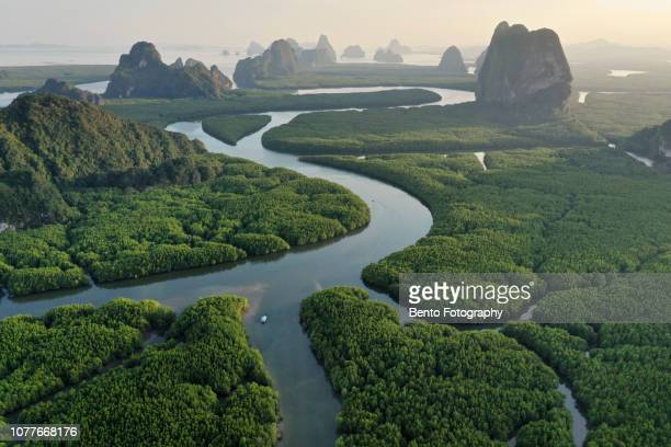 unseen thailand : aerial view of phang nga bay in the sunset, thailand - rivier stockfoto's en -beelden