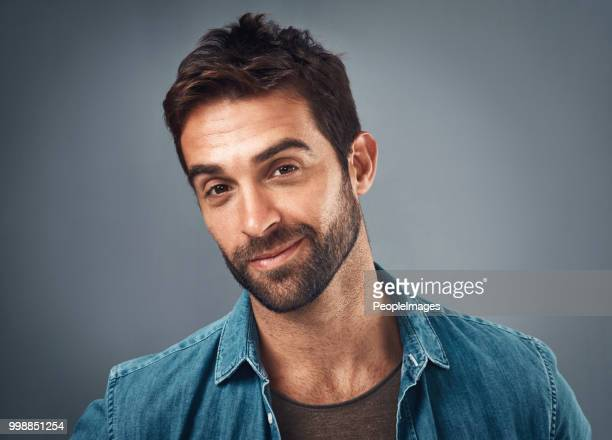 unshaven but still as smooth as ever - smirking stock pictures, royalty-free photos & images