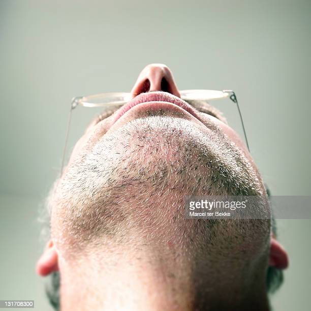 unshaven chin of man - head back stock pictures, royalty-free photos & images