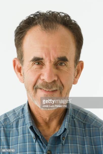 Unshaven Hispanic man