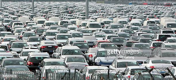 Unsold cars and vans sit on the dockside at Grimsby freight docks on January 30 2009 in Grimsby England Sales of new cars in the UK have slumped to a...