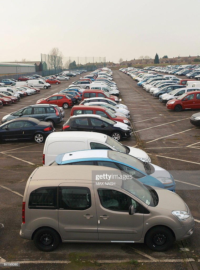 Unsold new cars are pictured parked in a Pictures | Getty Images