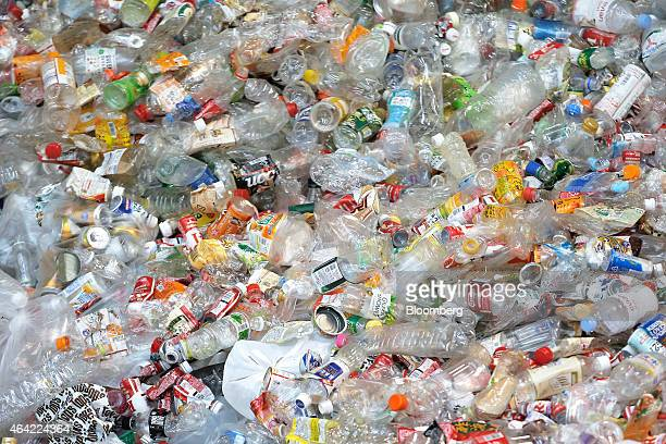 Unsorted recyclable materials including plastic bottles made of polyethylene terephthalate steel and aluminum cans sit in a pile as they wait to be...