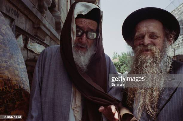 Unspecified Jewish men, one wearing a prayer shawl and the other a black hat, both with grey beards, in Jerusalem, Israel, 1988.