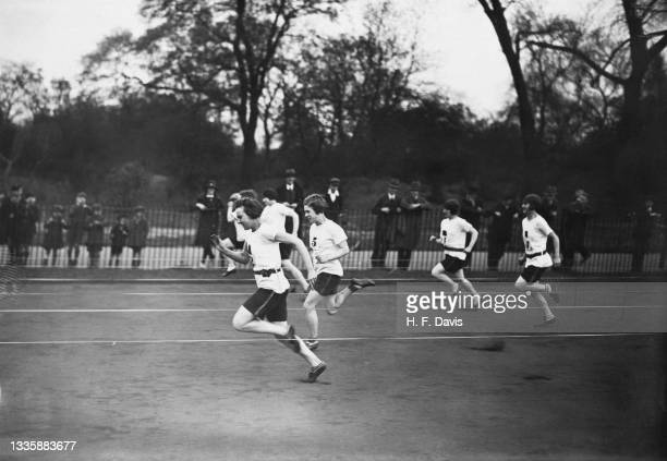 Unspecified runners at the start of the 100 yards race during the Polytechnic Ladies Club sports meeting, held at Battersea Park in London, England,...