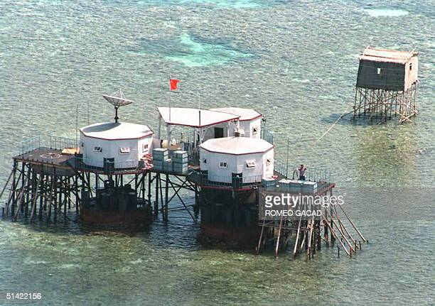 China's flag flies over octagonal structures built on stilts in the Manilaclaimed Mischief Reef in the disputed Spratly Islands located in the South...