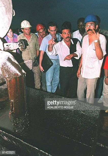 Cuban Foreign minister Roberto Robaina talks to oil workers and diplomatic corp members 26 April at a new oil deposit in Ciego de Avila Cuba 600kms...