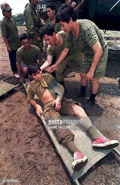 Peruvian army Sargent Mario Campos is helped onto a stretcher 19 February at a military airport at Ciro Alegria 20 miles from the border with Ecuador...