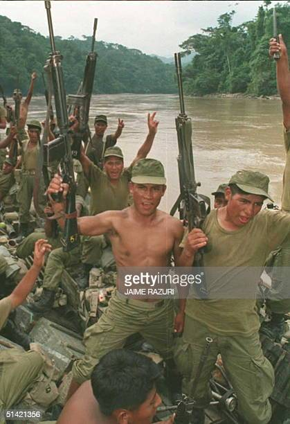 Peruvian soldiers point their guns in the air as they near the Ciro Alegria military base 11 February in the Peruvian Amazon Peru has reportedly sent...