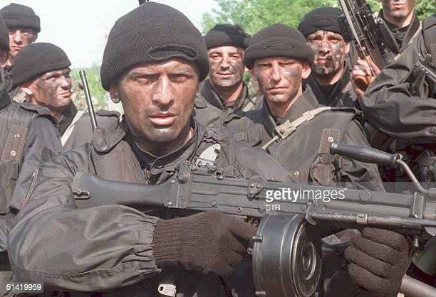 Serbian soldiers members of the special Super Tigers voluntary unit led by Zeljko Arkan Raznatovic sport face paint 11 June as they prepare to patrol...