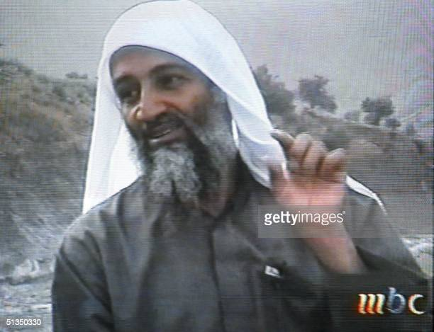 This frame grab from the Saudiowned television network MBC shows alleged terror mastermind Osama bin Laden gesturing an undated videotape broadcast...