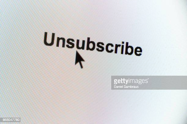 """""""Unsubscribe"""" web button and mouse arrow on computer screen"""