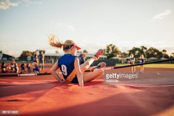 unsuccesful high jump attempt - sports training camp stock pictures, royalty-free photos & images