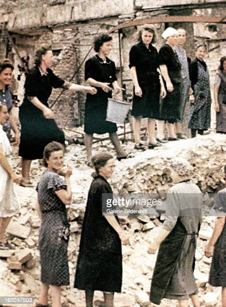 """Unsung heroines, """"Trümmer - Frauen"""" are collecting usable bricks from a ruin to rebuild the city. July 1945. Most were paid with a hot meal. More..."""