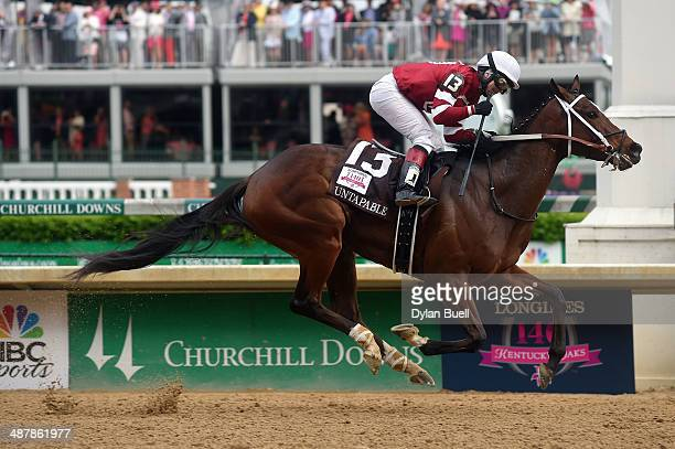Untapable ridden by Rosie Napravnik crosses the finish line to win the 140th running of the Kentucky Oaks at Churchill Downs on May 2 2014 in...