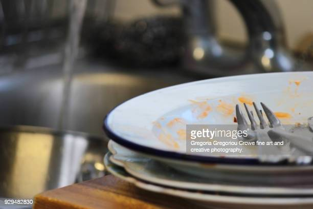 untidy house -dirty dishes at sink. - gregoria gregoriou crowe fine art and creative photography. stock pictures, royalty-free photos & images