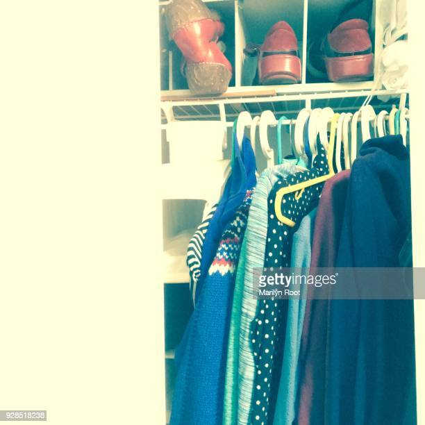 Untidy house full clothes closet women's clothes