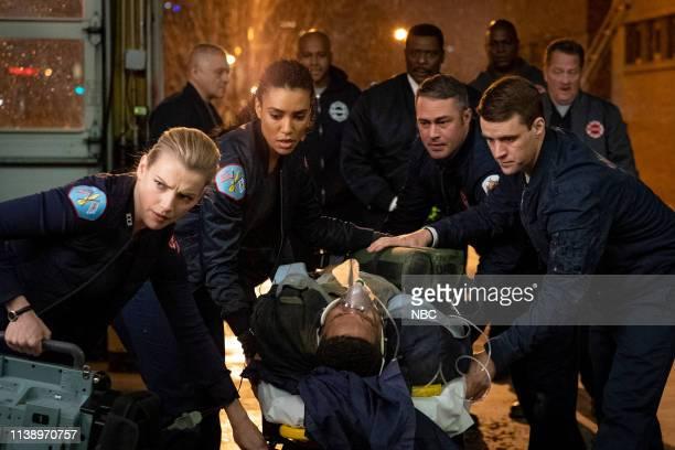 FIRE Until The Weather Breaks Episode 719 Pictured Kara Killmer as Sylvie Brett Annie Ilonzeh as Emily Foster Taylor Kinney as Kelly Severide Jesse...