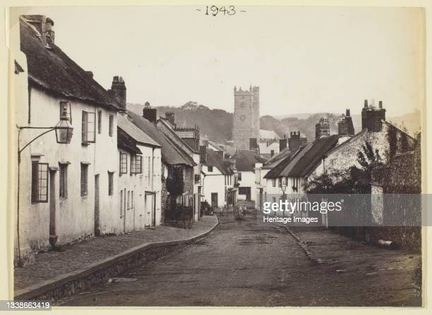 Untitled [thatched cottages and church], 1860/94. Albumen print. Artist Francis Bedford.