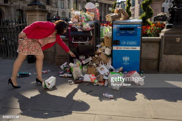 Untypical overflowing rubbish and litter collects over bins and recycling receptacles in Bank Triangle in the City of London - the capital's...