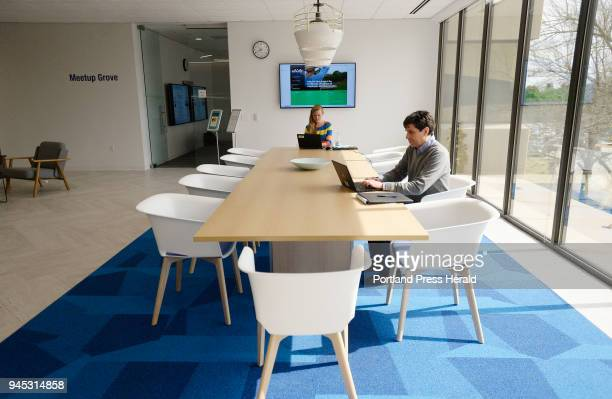 Unum employees Shelby Kaplan and Josh Casey work at a table in the recently renovated Unum office in Portland Friday April 6 2018