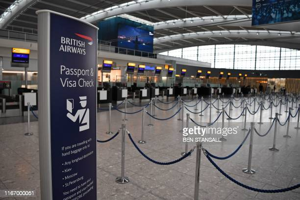 Unused checkin desks are pictured in a neardeserted departure area at Heathrow airport Terminal 5 in west London on September 9 as the airline's...