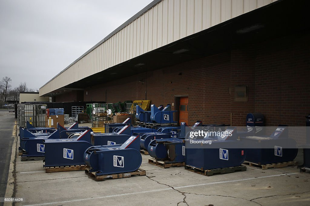 Unused mail drop boxes sit behind a loading dock at the United States Postal Service (USPS) sorting center in Louisville, Kentucky, U.S., on Friday, Jan. 13, 2017. Starting January 22, the cost of mailing a one-ounce first-class letter will return to being 49 cents, up from 47 cents, where it had been since April. Photographer: Luke Sharrett/Bloomberg via Getty Images