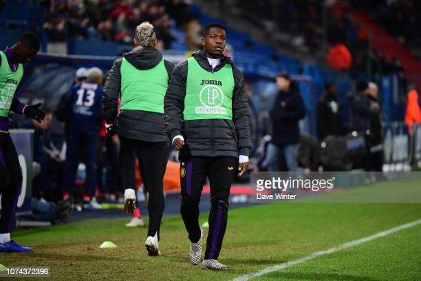 Unused substitute Aaron Leya Iseka of Toulouse warms up during the Ligue 1 match between Caen and Toulouse at Stade Michel D'Ornano on December 18...