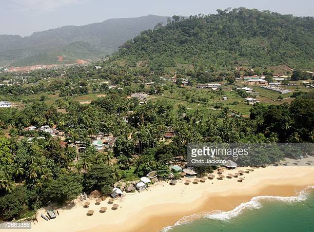Unused sun shades lie on the beach just outside Freetown on November 28 2006 near Freetown Sierra Leone The country is trying to attract tourists but...