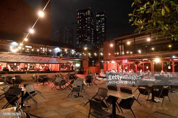 Unused tables and chairs are seen outside Dukes Bar in Castlefield in Manchester city centre northwest England ahead of new coronavirus restrictions...