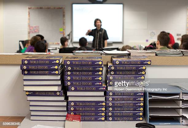 Unused textbooks stacked in class as High school students learn in the Manor New Tech High School an innovative classroom setting that centers on...