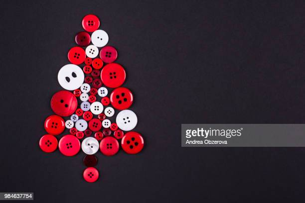 Unusual christmas tree design, white and red buttons tree christmas background, isolated on dark gre