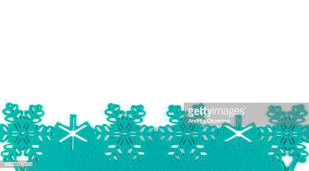 unusual design christmas background with turquoise snowflakes and copy space on white background - christmas background stock photos and pictures