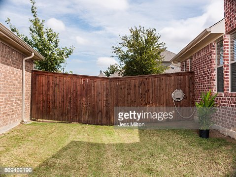 Unusual fence in between 2 brick homes